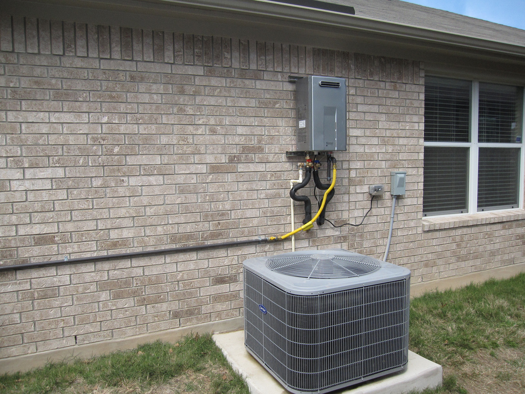 9 best practices for choosing and installing a tankless - Exterior hot water heater enclosure ...